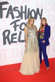 Paris Hilton looked princess-y in a gold sequin gown at the Fashion for Relief Cannes 2018.