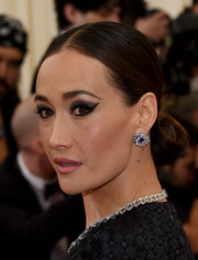 Maggie Q finished off her look with a stunning pair of diamond and sapphire studs.