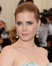 Amy Adams complemented her hairstyle with a lovely pair of dangling crystal earrings by David Webb.