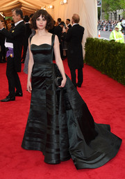 Felicity Jones donned a lovely black Theory by Olivier Theyskens silk gown for the Met Gala.