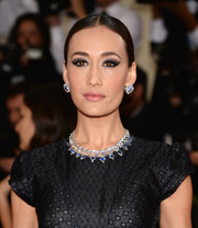 Maggie Q looked like royalty with her diamond and sapphire necklace and matching earrings at the Met Gala.