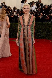 Maggie Gyllenhaal brought a playful vibe to the Met Gala red carpet with this multicolored circle-print gown by Valentino.