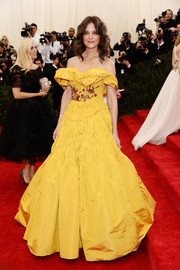 Katie Holmes brought a bright pop of color to the Met Gala red carpet with this Scarlett O'Hara-inspired yellow off-the-shoulder gown by Marchesa.