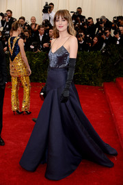 Dakota Johnson looked sultry on the Met Gala red carpet in a low-cut, beaded camisole by Jason Wu.