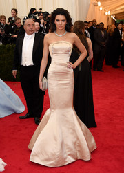 Kendall Jenner looked absolutely stunning on the Met Gala red carpet in a blush-colored strapless mermaid gown by Topshop.