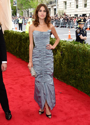 Alexa Chung looked adorable at the Met Gala in a ruched gray Nina Ricci strapless gown with a row of bows down the front.