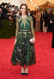 Sarah Paulson showed off her unique style with this embellished green sheer-overlay dress by Prada during the Met Gala.