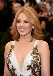 Kylie Minogue was as gorgeous as ever at the Met Gala wearing a feathery half-up 'do.