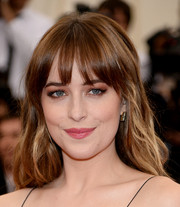 Dakota Johnson sported a girl-next-door wavy 'do with wispy bangs at the Met Gala.