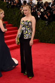 Chloe Sevigny walked the Met Gala red carpet wearing a Kenzo peplum gown with a patterned bodice.