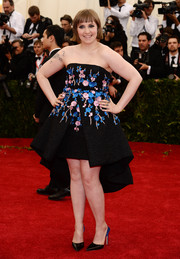 Lena Dunham looked adorable in a floral-embroidered high-low strapless dress by Giambattista Valli Couture during the Met Gala.