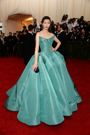 Liu Wen stepped out on the Met Gala red carpet wearing this stunner of a gown, an aqua-blue Zac Posen strapless dress with a skirt that went on and on.