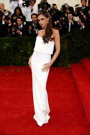 Victoria Beckham went for minimalist elegance at the Met Gala in a white strapless gown from her own label.