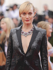 Amber Valletta teamed a gemstone statement necklace with a sequined tux for a fabulously glam look during the Met Gala.