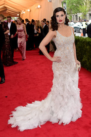 Idina Menzel was all jazzed up in a beaded Donna Karan Atelier gown, featuring a long, frilly train, during the Met Gala.