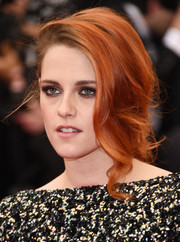 Kristen Stewart opted for a soft, loose fishtail braid with wavy tendrils down one side when she attended the Met Gala.