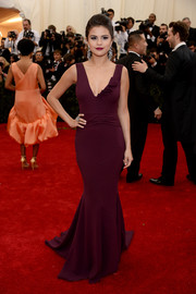 Selena Gomez showed off some fabulous curves at the Met Gala in a slinky plum-colored gown by Diane von Furstenberg.