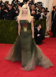 Donatella Versace chose a forest-green strapless gown with a voluminous tulle train for her Met Gala red carpet look.