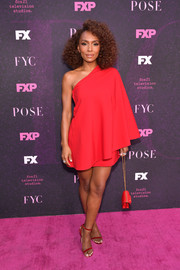 Janet Mock looked ultra chic in a one-shoulder mini dress by Valentino at the 'Pose' red carpet event.