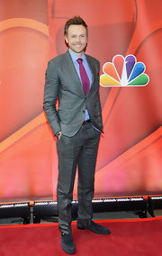 Joel McHale dressed up a pair of casual jeans with this gray two-button suit.