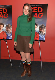 A solid green turtleneck added a splash of color to Josephine Decker's look at the 'Red Flag' screening in New York.