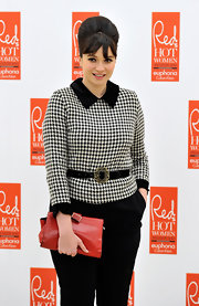 Gizzi looked perfectly mod holding a red retro style clutch. A bouffant and houndstooth coat completed her vintage-inspired look.