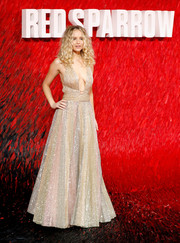 Jennifer Lawrence looked totally dazzling at the European premiere of 'Red Sparrow' in a multi-pastel Dior Couture gown studded all over with gold sequins.