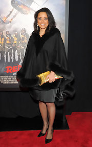 'American Idol' alum Kimberly Locke kept covered up in a dramatic fur-trimmed cape at the 'Red Tails' premiere.