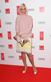 Amber Le Bon wore a two-tone lace pencil skirt with her sweater for a more sophisticated finish.