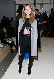 Nina Garcia kept warm in style with a gray wool coat featuring black fur sleeves when she attended the Reed Krakoff Fall 2013 fashion show.