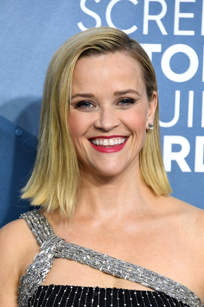 Reese Witherspoon Flip [hair,face,blond,hairstyle,facial expression,eyebrow,smile,chin,beauty,lip,arrivals,reese witherspoon,actor,screen actors guild awards,screen actors\u00e2 guild awards,award,hair,face,the shrine auditorium,california,reese witherspoon,24th screen actors guild awards,actor,shrine auditorium and expo hall,sag-aftra,screen actors guild,celebrity,critics choice movie awards,award]