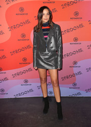 Georgie Flores completed her ensemble with black suede ankle boots.