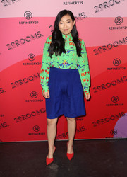 Awkwafina teamed her blouse with long shorts in a gorgeous royal-blue hue.
