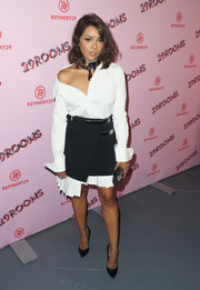 Kat Graham layered a Mugler wraparound mini skirt over her dress for an even trendier look.