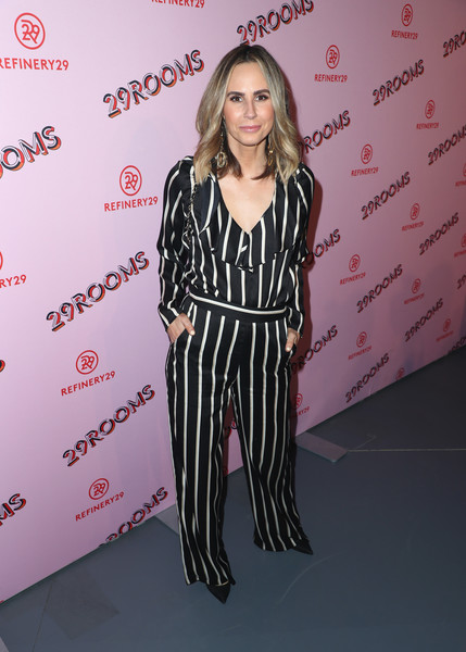 Keltie Knight attended the Turn It Into Art opening night party wearing a black-and-white striped ruffle blouse.