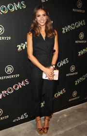 Jessica Alba was business-chic in a black pinstriped jumpsuit while attending the 29Rooms event.