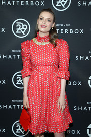 Gillian Jacobs matched a red Building Block purse with a micro-print dress for the Shatterbox celebration.