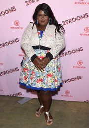 Gabourey Sidibe layered a white lace bomber jacket over a colorful print dress for the 29Rooms: Turn It Into Art event.