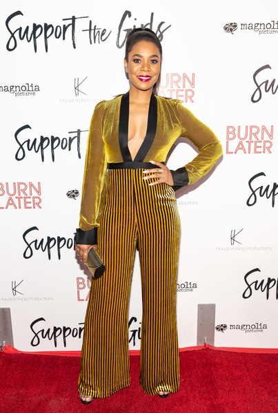 Regina Hall Studded Clutch [support the girls,yellow,flooring,carpet,fashion,fashion model,red carpet,fashion design,formal wear,regina hall,arclight hollywood,california,magnolia pictures,premiere,premiere]