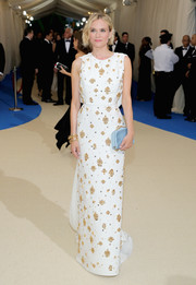 Diane Kruger looked downright regal at the 2017 Met Gala in a white Prada column dress with gold beading.