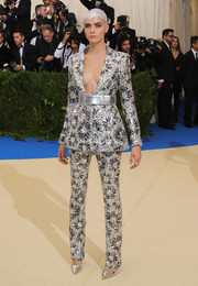 Cara Delevingne made a spectacular entrance in a heavily embellished silver and black pantsuit by Chanel Couture at the 2017 Met Gala.