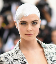 With a bald head, silver paint, and some crystals, Cara Delevingne achieved the most standout 'hairstyle' at the 2017 Met Gala!