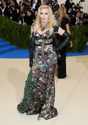 Madonna looked ready for (sartorial) combat in a camo-print corset gown by Moschino at the 2017 Met Gala.