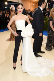 Emmy Rossum opted for black Carolina Herrera cigarette pants instead of a dress when she attended the 2017 Met Gala.