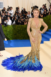 Blake Lively was a vision in gold chains and blue feathers at the 2017 Met Gala!