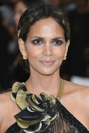Halle Berry styled her hair into a center-parted chignon for the 2017 Met Gala.
