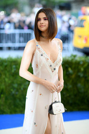 Selena Gomez attended the 2017 Met Gala carrying an adorable printed purse by Coach.
