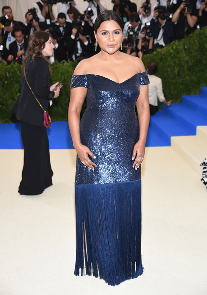 More Pics of Mindy Kaling Chignon (6 of 11) - Mindy Kaling Lookbook - StyleBistro [rei kawakubo/comme des garcons: art of the in-between,rei kawakubo/comme des garcons: art of the in-between,dress,clothing,fashion model,shoulder,fashion,gown,red carpet,carpet,haute couture,flooring,costume institute gala - arrivals,mindy kaling,new york city,metropolitan museum of art,costume institute gala]