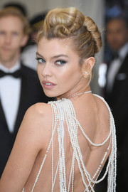 Stella Maxwell rocked an exaggerated French twist at the 2017 Met Gala.