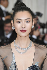 Liu Wen added more sparkle with some layered diamond necklaces.